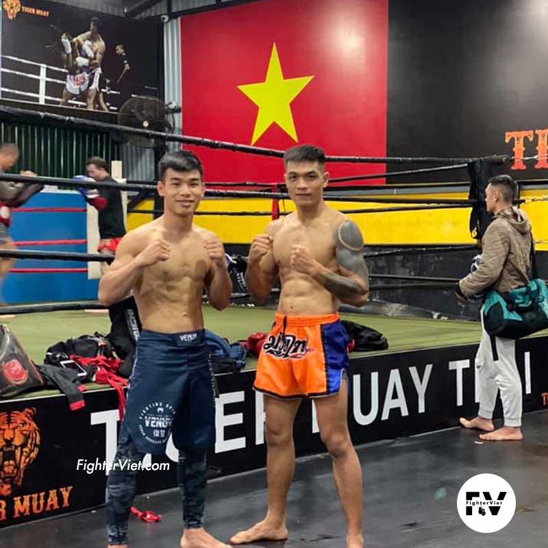 Quần Muay Thái Another Boxer Cam Xanh Đẹp